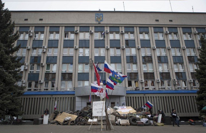 A barricade is set up in front of the seized SBU state security service in Luhansk, in eastern Ukraine