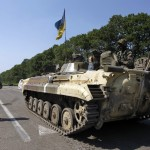Ukrainian soldiers stand guard at a Ukrainian checkpoint near the eastern town of Slaviansk